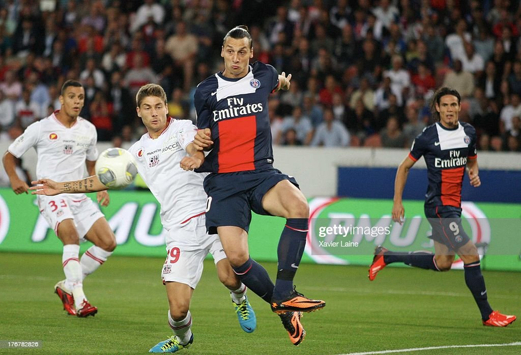 Zlatan Ibrahimovic (R) of Paris Saint-Germain and Paul Lasne of Ajaccio AC in action during the French League 1 between Paris Saint-Germain FC and AC Ajaccio, at Parc des Princes on August 18, 2013 in Paris, France.
