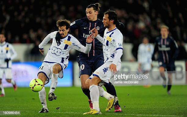 Zlatan Ibrahimovic of Paris SaintGermain battles with Fethi Harek of SC Bastia during the Ligue 1 match between Paris SaintGermain FC and SC Bastia...