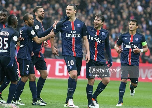 Zlatan Ibrahimovic of Paris SaintGermain celebrate his second goal with Lucas Moura Thiago Motta Maxwell and Thiago Silva during the French Ligue 1...