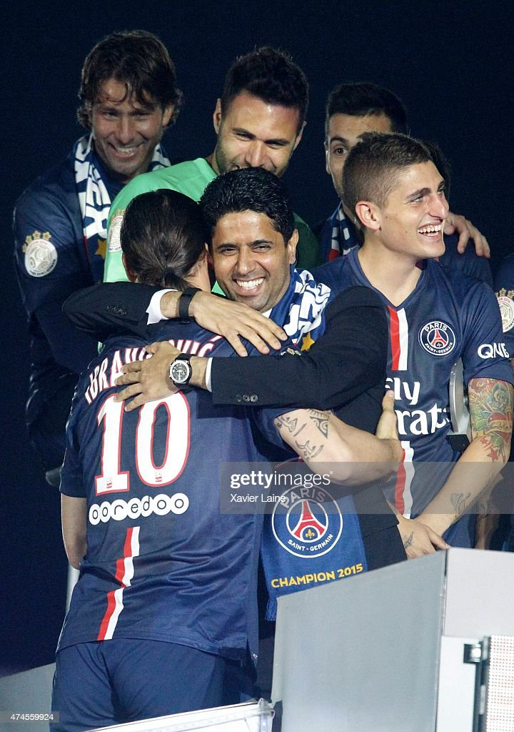 Zlatan Ibrahimovic of Paris Saint-Germain celebrate the victory of championship with Nasser Al-Khelaifi and team-mattes after the French Ligue 1 between Paris Saint-Germain FC and Stade de Reims at Parc Des Princes on may 23, 2015 in Paris, France.