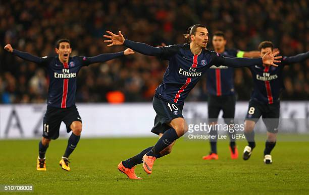 Zlatan Ibrahimovic of Paris SaintGermain celebrates as he scores their first goal from a free kick during the UEFA Champions League round of 16 first...