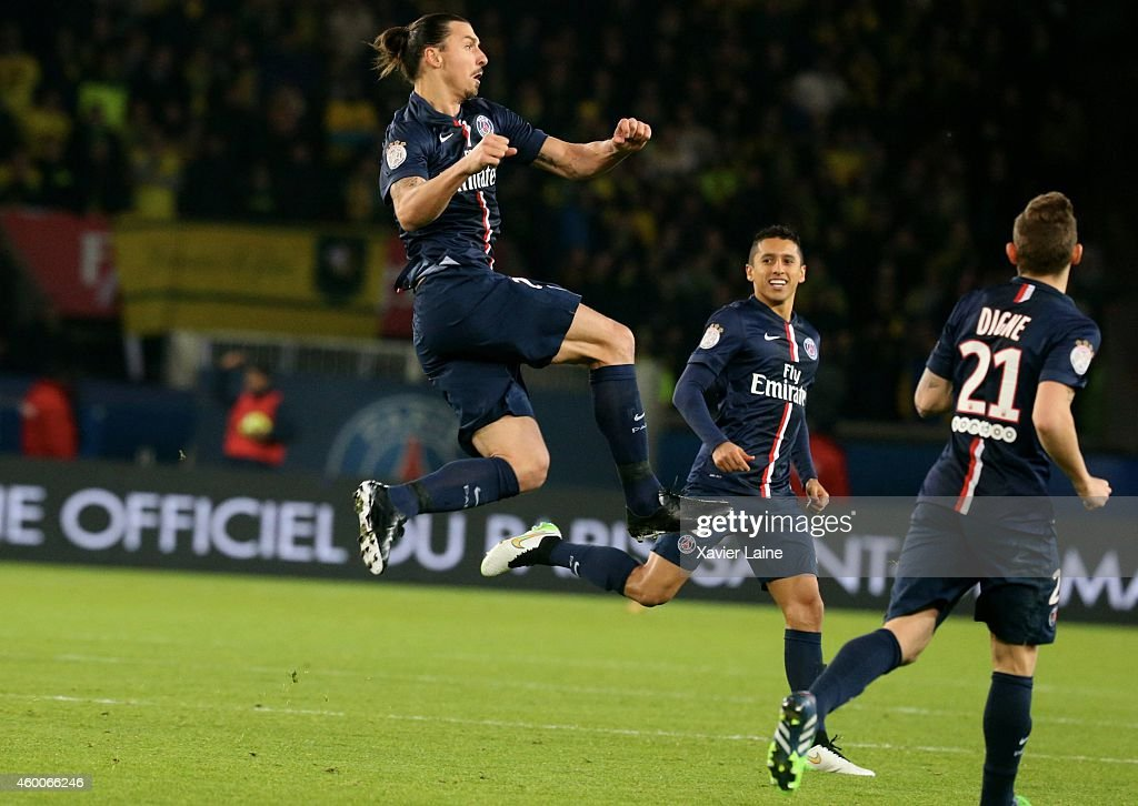 Zlatan Ibrahimovic of Paris Saint-Germain celebrates his second goal with Marquinhos during the French Ligue 1 between Paris Saint-Germain FC and FC Nantes at Parc Des Princes on December 06, 2014 in Paris, France.