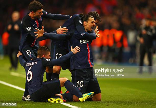 Zlatan Ibrahimovic of Paris SaintGermain celebrates with team mates as he scores their first goal from a free kick during the UEFA Champions League...