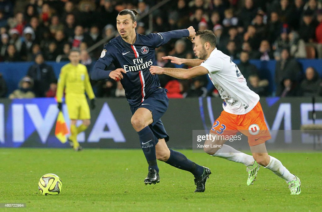 Zlatan Ibrahimovic of Paris Saint-Germain in action with Jamel Saihi of Montpellier Herault SC during the French Ligue 1 between Paris Saint-Germain FC and Montpellier Herault SC at Parc Des Princes on December 20, 2014 in Paris, France.