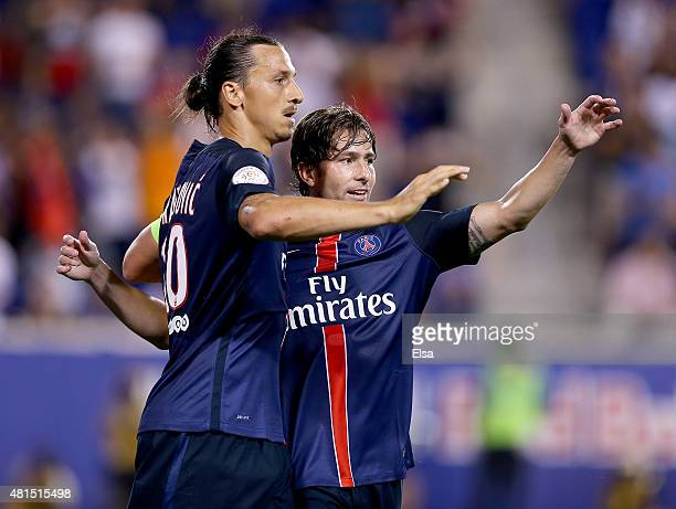 Zlatan Ibrahimovic of Paris SaintGermain is congratulated by teamamte Maxwell after Ibrahimovic scored a goal in the second half against AFC...