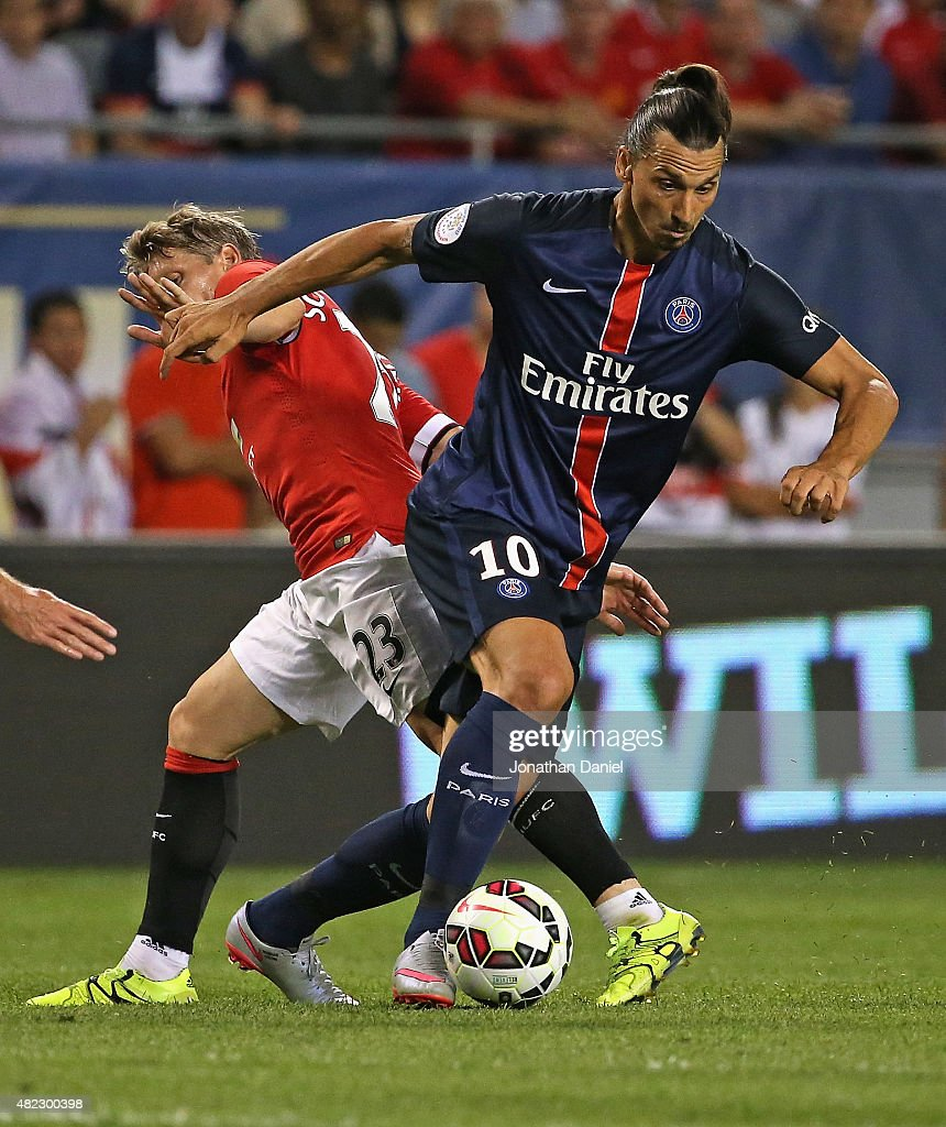 Zlatan Ibrahimovic #10 of Paris Saint-Germain moves around Bastain Schweinsteiger #23 of Manchester United during a match in the 2015 International Champions Cup at Soldier Field on July 29, 2015 in Chicago, Illinois.