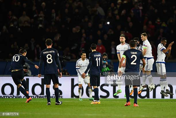 Zlatan Ibrahimovic of Paris SaintGermain scores their first goal from a free kick during the UEFA Champions League round of 16 first leg match...
