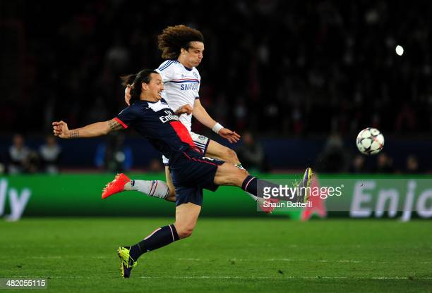 Zlatan Ibrahimovic of PSG and David Luiz of Chelsea compete for the ball during the UEFA Champions League quarter final, first leg match between...