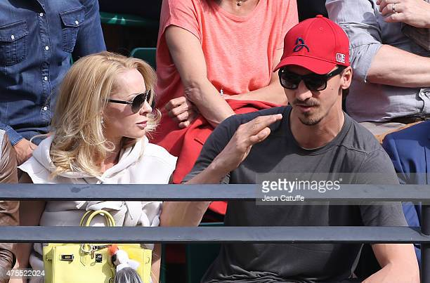Zlatan Ibrahimovic of PSG and his wife Helena Seger cheer for their friend Novak Djokovic of Serbia during his match against Gilles Muller of...