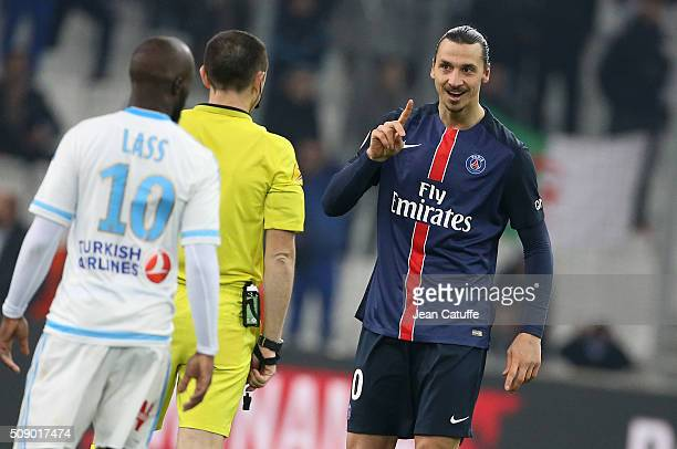 Zlatan Ibrahimovic of PSG argues with referee Ruddy Buquet during the French Ligue 1 match between Olympique de Marseille and Paris SaintGermain at...