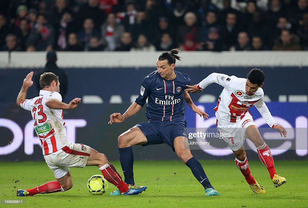 Zlatan Ibrahimovic of PSG between Arnaud Maire and Benjamin Andre of AC Ajaccio in action during the French Ligue 1 match between Paris Saint Germain FC and AC Ajaccio at the Parc des Princes stadium on January 11, 2013 in Paris, France.