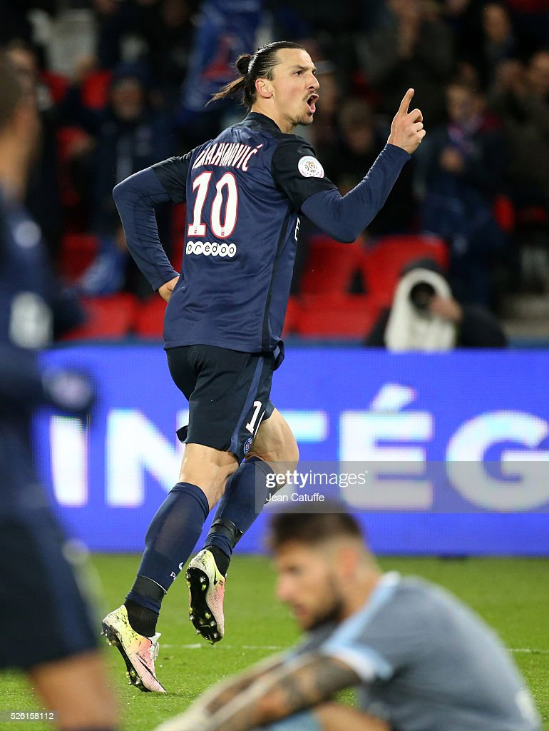 Zlatan Ibrahimovic of PSG celebrates his second goal while goalkeeper of Rennes Benoit Costil looks on during the French Ligue 1 match between Paris Saint-Germain (PSG) and Stade Rennais FC at Parc des Princes stadium on April 29, 2016 in Paris, France.
