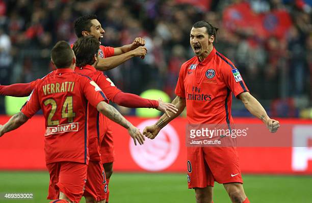 Zlatan Ibrahimovic of PSG celebrates scoring his second goal with Marquinhos of PSG and teammates during the French League Cup final between Paris...