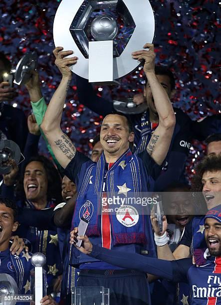 Zlatan Ibrahimovic of PSG celebrates with teammates winning the French Ligue 1 championship during the trophy ceremony following the French Ligue 1...