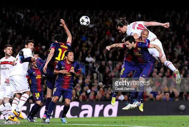 Zlatan Ibrahimovic of PSG climbs above Daniel Alves of Barcelona to head the ball towards goal during the UEFA Champions League quarterfinal second...