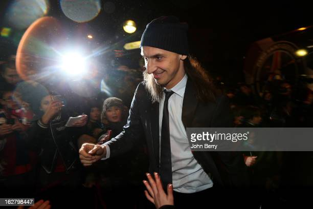 Zlatan Ibrahimovic of PSG greets fans as he arrives at the stadium ahead of the French Cup match between Paris Saint Germain FC and Olympique de...