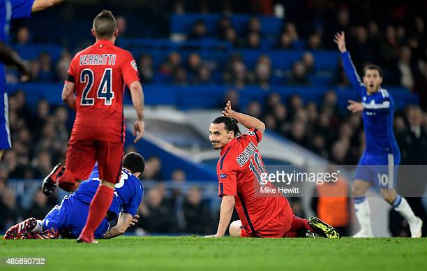 Zlatan Ibrahimovic of PSG holds his hand up in acknowledgement of the bad tackle he has just committed on Oscar of Chelsea during the UEFA Champions...