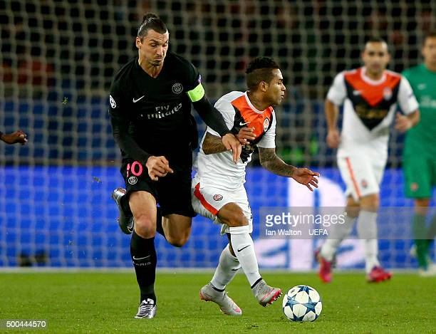 Zlatan Ibrahimovic of PSG holds off Alex Teixeira of Shakhtar during the UEFA Champions League Group A match between Paris SaintGermain and FC...