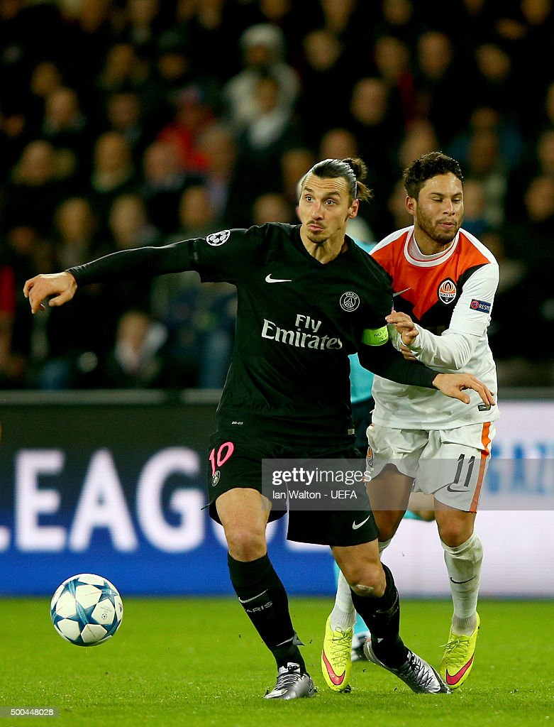 Zlatan Ibrahimovic of PSG holds off Marlos of Shakhtar during the UEFA Champions League Group A match between Paris Saint-Germain and FC Shakhtar Donetsk at Parc des Princes on December 8, 2015 in Paris, France.