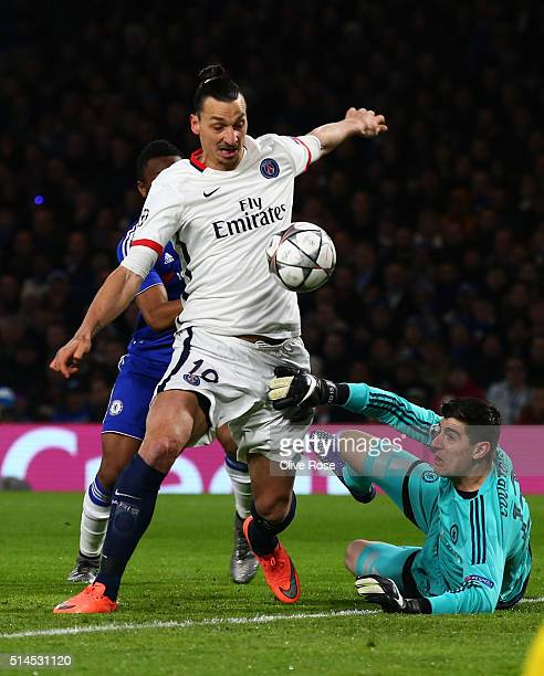 Zlatan Ibrahimovic of PSG is thwarted by Thibaut Courtois of Chelsea during the UEFA Champions League round of 16 second leg match between Chelsea...