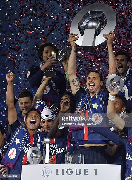 Zlatan Ibrahimovic of PSG lifts the trophy after the French Ligue betwee Paris Saint Germain and FC Nantes at Parc des Princes on May 14 2016 in...