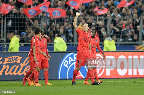 Zlatan Ibrahimovic of PSG reacts after scoring his second goal of the night with teammates Marquinhos Maxwell and Blaise Matuidi during the French...
