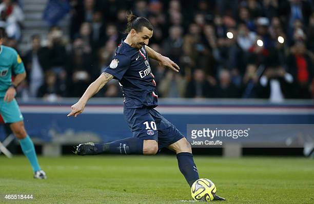 Zlatan Ibrahimovic of PSG scores a goal on a penalty kick during the French Ligue 1 match between Paris SaintGermain FC and RC Lens at Parc des...
