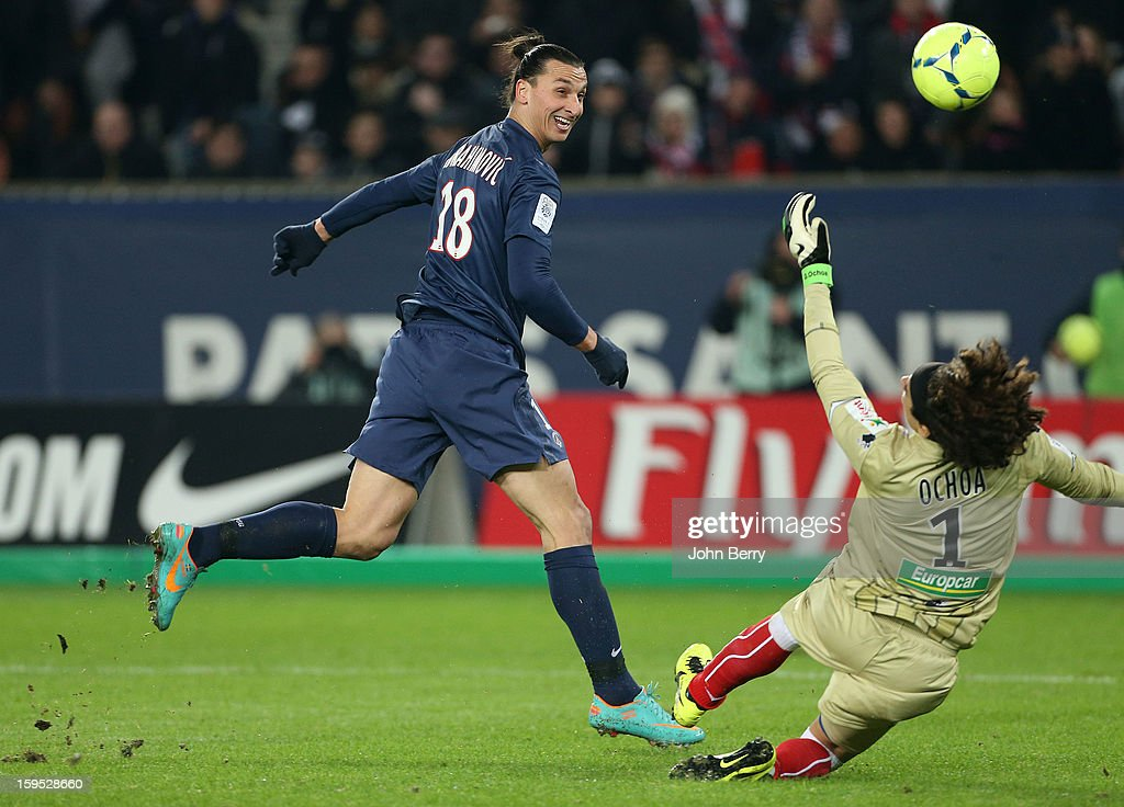 Zlatan Ibrahimovic of PSG shoots towards goal as Guillermo Ochoa, goalkeeper of AC Ajaccio tries to make a save during the French Ligue 1 match between Paris Saint Germain FC and AC Ajaccio at the Parc des Princes stadium on January 11, 2013 in Paris, France.
