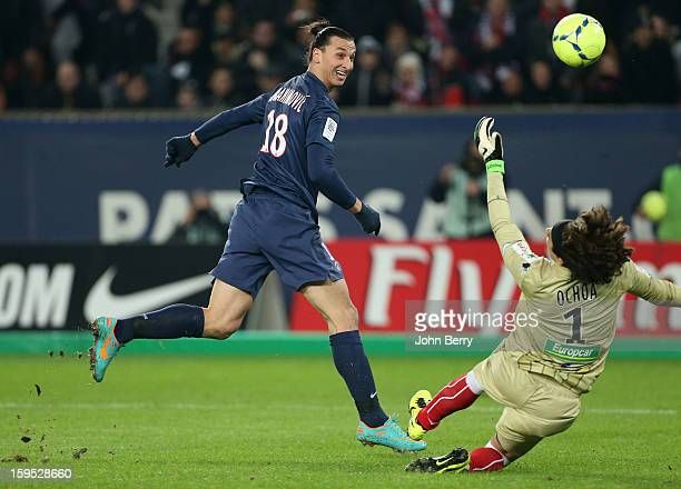 Zlatan Ibrahimovic of PSG shoots towards goal as Guillermo Ochoa goalkeeper of AC Ajaccio tries to make a save during the French Ligue 1 match...