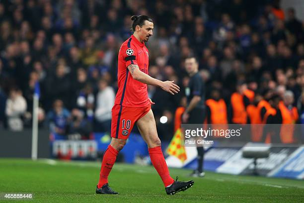 Zlatan Ibrahimovic of PSG walks off the pitch after receiving a straight red card for his tackle on Oscar of Chelsea during the UEFA Champions League...