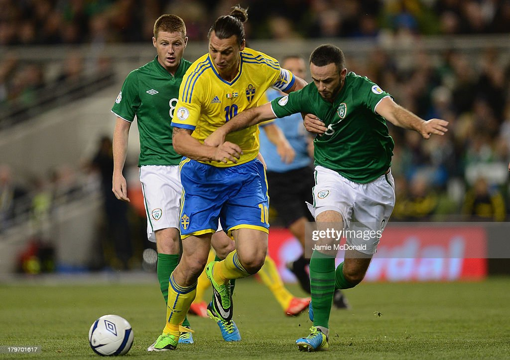 Zlatan Ibrahimovic of Republic of Ireland battles with Marc Wilson of Sweden during the FIFA 2014 World Cup Qualifying Group C match between Republic of Ireland and Sweden at Aviva Stadium on September 6, 2013 in Dublin, Ireland.