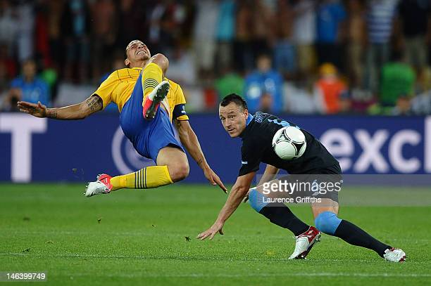 Zlatan Ibrahimovic of Sweden and John Terry of England compete for the ball during the UEFA EURO 2012 group D match between Sweden and England at The...