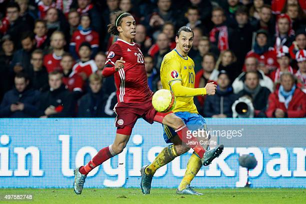 Zlatan Ibrahimovic of Sweden and Yussuf Poulsen of Denmark in action during the UEFA EURO 2016 qualifier playoff second leg match between Denmark and...