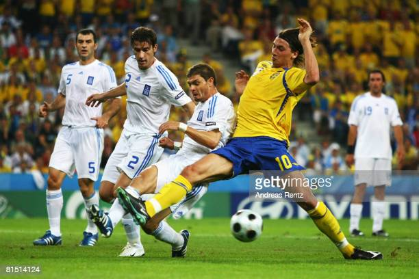 Zlatan Ibrahimovic of Sweden challenges Angelos Charisteas and Giourkas Seitaridis of Greece during the UEFA EURO 2008 Group D match between Greece...