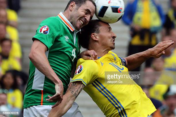 Zlatan Ibrahimovic of Sweden clashes John O'Shea of Republic of Ireland during the UEFA EURO 2016 Group E match between Republic of Ireland and...