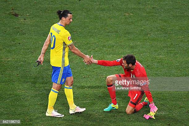 Zlatan Ibrahimovic of Sweden consoles teammate Andreas Isaksson of Sweden after defeat in the UEFA EURO 2016 Group E match between Sweden and Belgium...