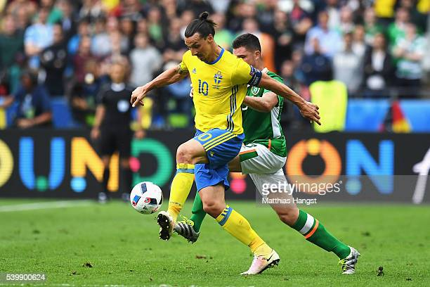 Zlatan Ibrahimovic of Sweden controls the ball under pressure of Ciaran Clark of Republic of Ireland during the UEFA EURO 2016 Group E match between...