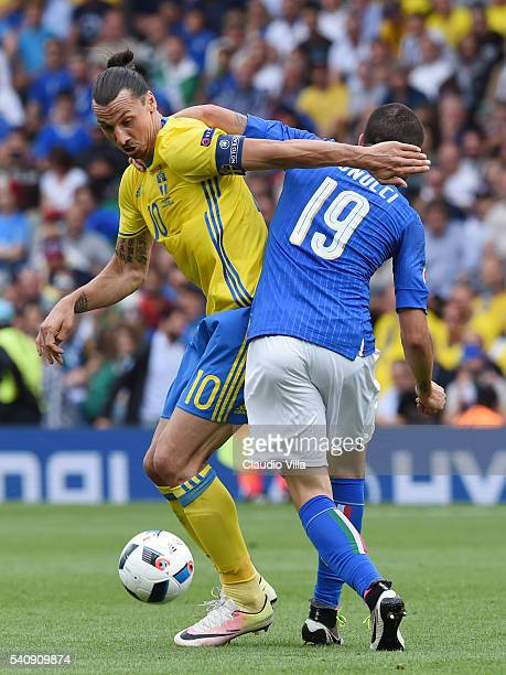 Zlatan Ibrahimovic of Sweden holds off Leonardo Bonucci of Italy during the UEFA EURO 2016 Group E match between Italy and Sweden at Stadium...