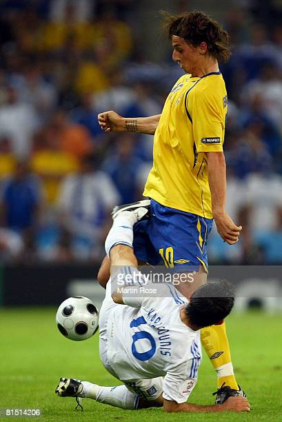 Zlatan Ibrahimovic of Sweden is tackled by Georgios Karagounis of Greece during the UEFA EURO 2008 Group D match between Greece and Sweden at Stadion...