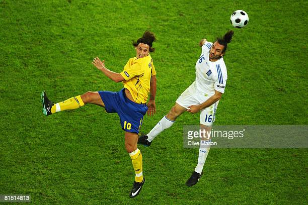 Zlatan Ibrahimovic of Sweden jumps for a header with Sotirios Kyrgiakos of Greece during the UEFA EURO 2008 Group D match between Greece and Sweden...