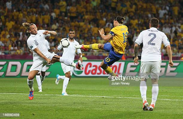 Zlatan Ibrahimovic of Sweden scores the opening goal during the UEFA EURO 2012 group D match between Sweden and France at The Olympic Stadium on June...