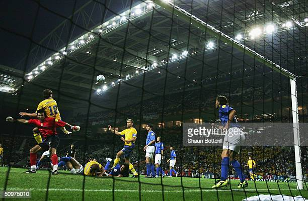Zlatan Ibrahimovic of Sweden scores their first goal during the UEFA Euro 2004 Group C match between Italy and Sweden at the Estadio Dragao on June...