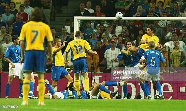Zlatan Ibrahimovic of Sweden scores their first goal with a back heal during the UEFA Euro 2004 Group C match between Italy and Sweden at the Estadio...