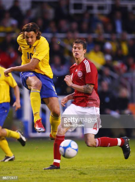 Zlatan ibrahimovic of Sweden shoots past Daniel Agger of Denmark during the FIFA2010 World Cup Qualifying Group 1 match between Sweden and Denmark at...