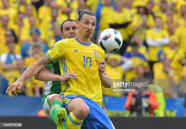Zlatan Ibrahimovic of Sweden vies for the ball with John O'Shea of Irland during the Group E soccer match of the UEFA EURO 2016 between Ireland and...