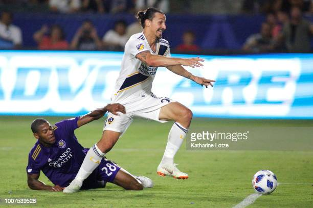 Zlatan Ibrahimovic of the Los Angeles Galaxy and Chris Schuler of Orlando City SC fight for control of the ball at StubHub Center on July 29 2018 in...