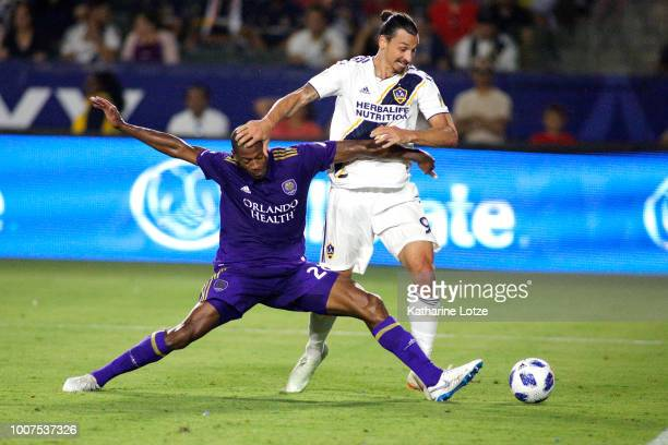 Zlatan Ibrahimovic of the Los Angeles Galaxy and Chris Schuler of the Orlando City SC fight for control of the ball at StubHub Center on July 29 2018...