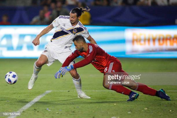Zlatan Ibrahimovic of the Los Angeles Galaxy and Earl Edwards Jr #36 of Orlando City SC fight for control of the ball at StubHub Center on July 29...
