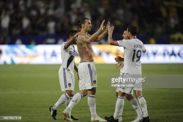 Zlatan Ibrahimovic of the Los Angeles Galaxy highfives teammate Chris Pontius at StubHub Center on July 29 2018 in Carson California