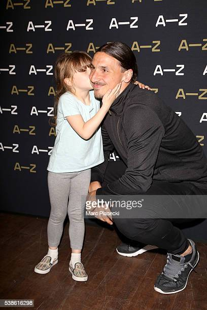 Zlatan Ibrahimovic poses with a young fan during the Zlatan Ibrahimovic Launches AZ Line on June 7 2016 in Paris France